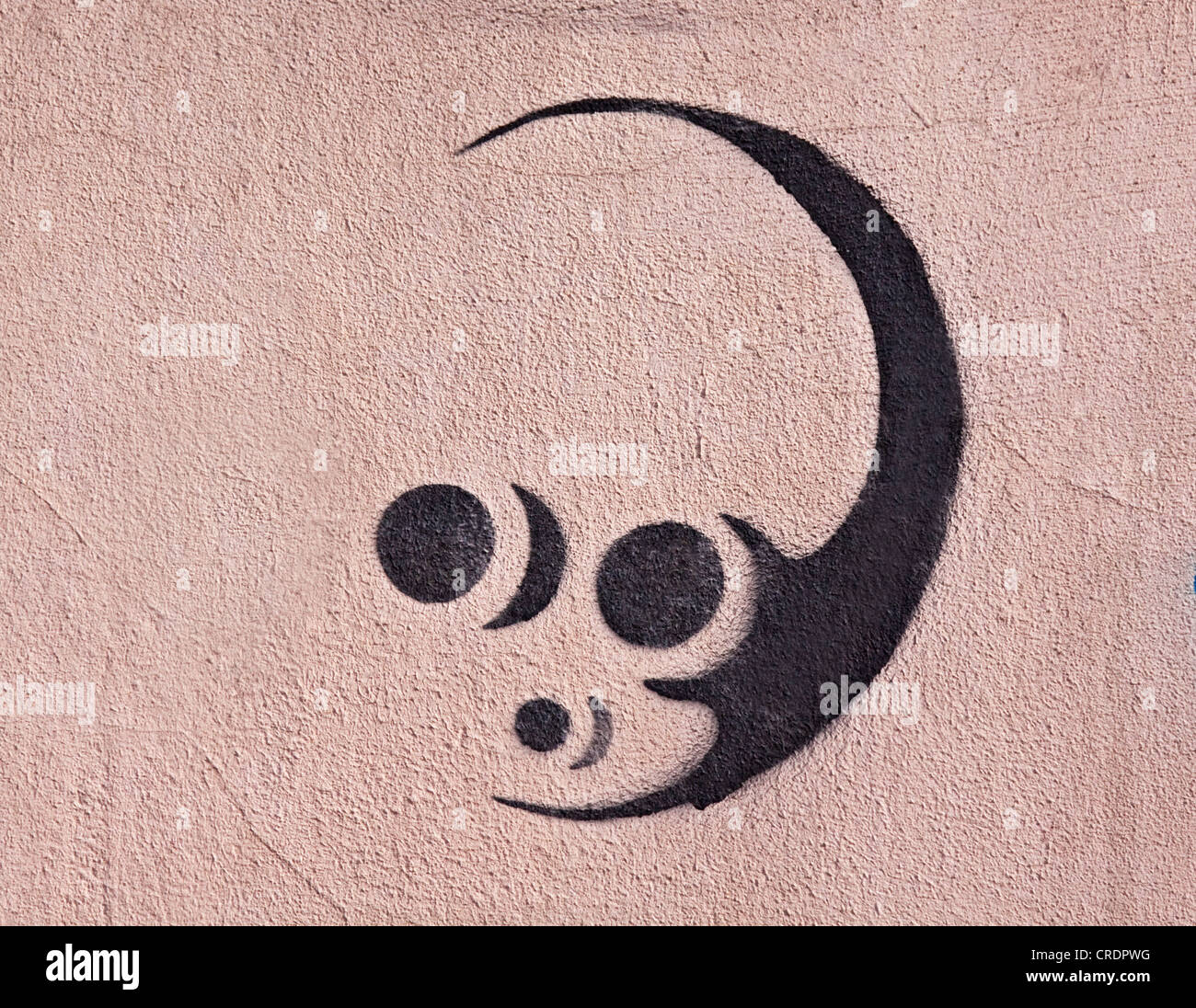 Alien, stencil graffiti on the wall of a building, Riga, Latvia, Europe - Stock Image