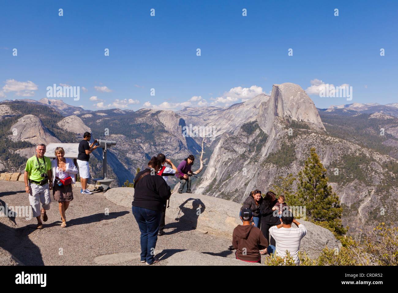 Visitors admiring Half Dome in Yosemite - Stock Image