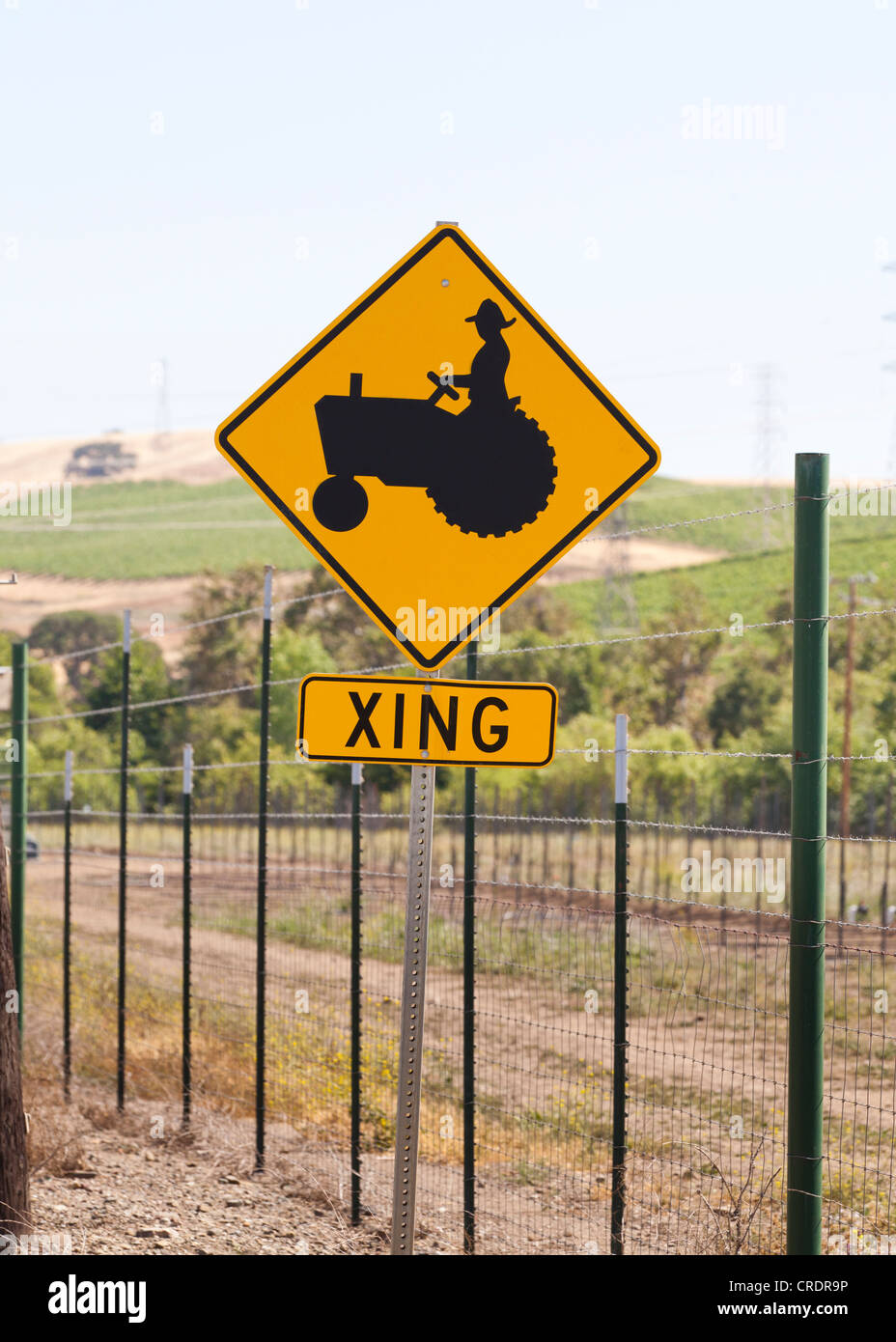 Tractor crossing sign - Stock Image