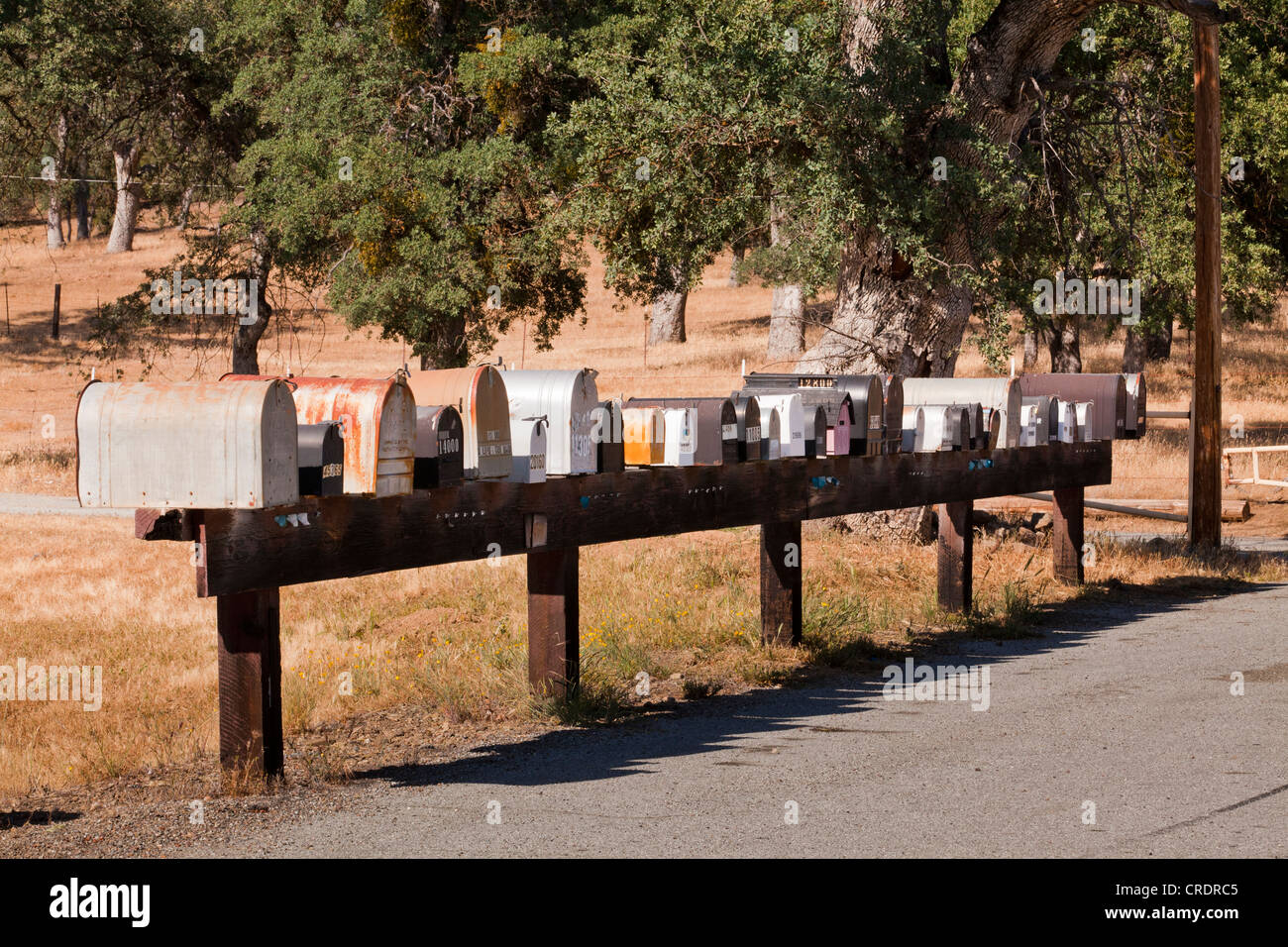 Row of mailboxes in rural America - Stock Image