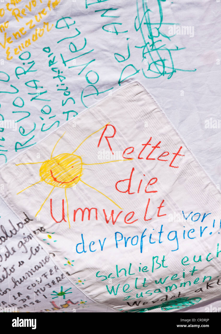 Rettet die Umwelt or Save the Environment, written on and painted on sheet, environmental conservation - Stock Image