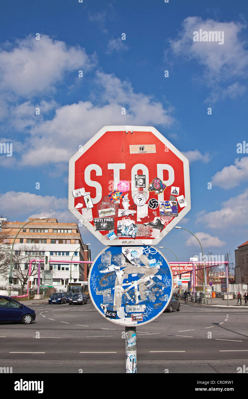 Stop sign defaced with stickers, and direction arrow, Berlin, Germany, Europe - Stock Image