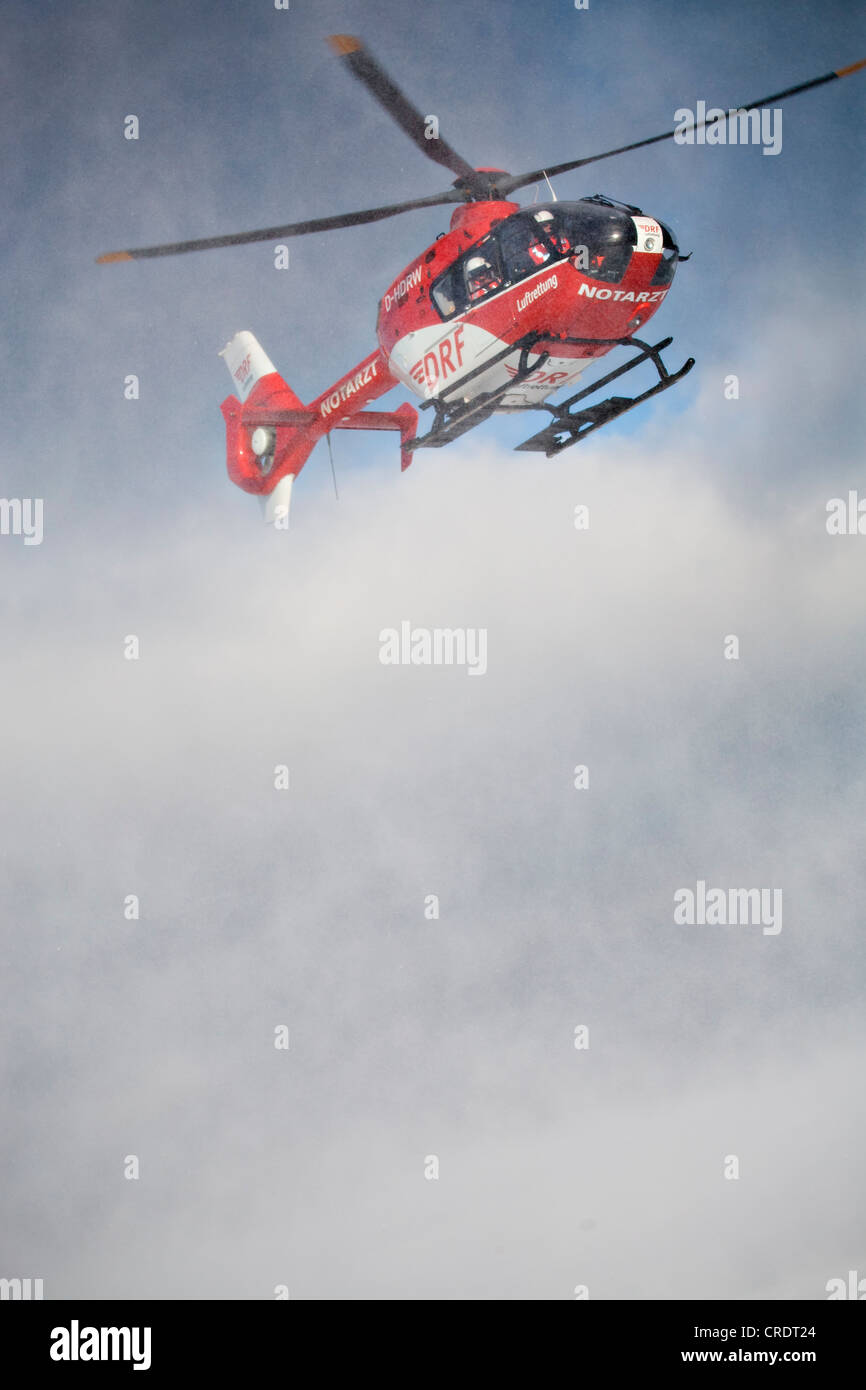 Rescue helicopter approaching, rescue operation with a rescue helicopter in the Thuringian Slate Mountains, Thuringia - Stock Image