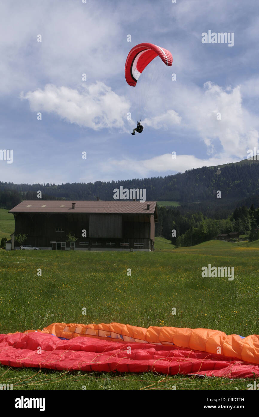 paraglider landing, Switzerland, Appenzell, Jakobsbad Stock Photo
