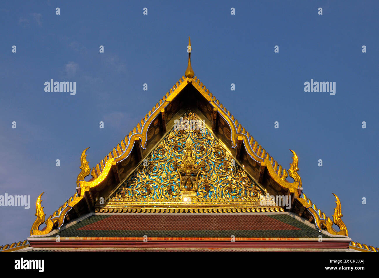 Pediment with Garuda and Nagas, Chofahs, sky tassel, characteristic architectural ornaments on the roof of Buddhist - Stock Image