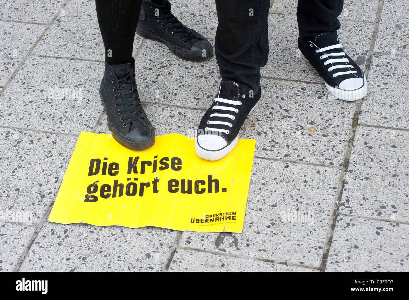 Sign 'Die Krise gehoert euch', German for 'The crisis is yours', demonstration by 30000 trade union - Stock Image