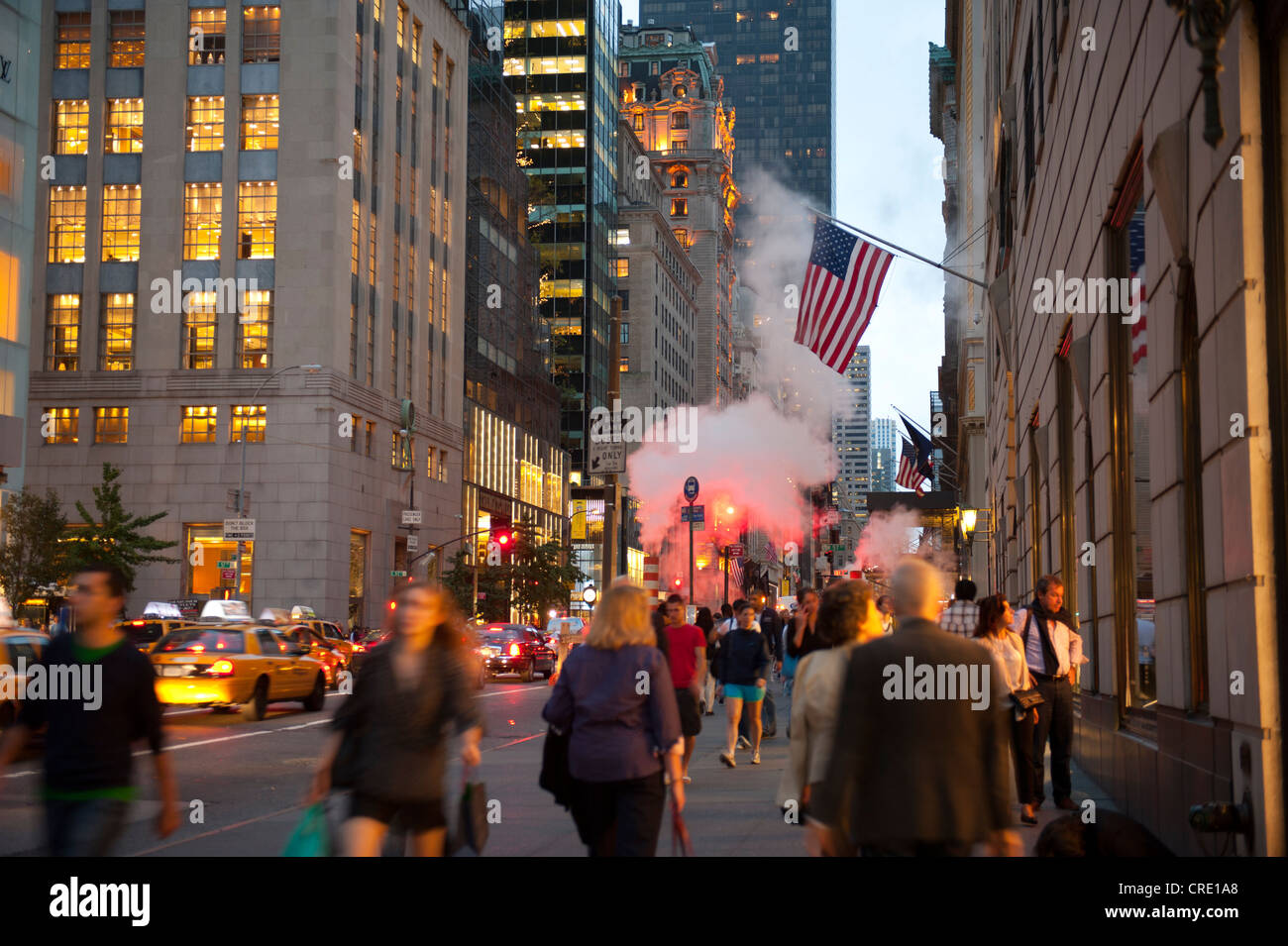 Many people on 5th Avenue close to Trump Tower in the evening, Midtown, Manhattan, New York City, USA, North America - Stock Image