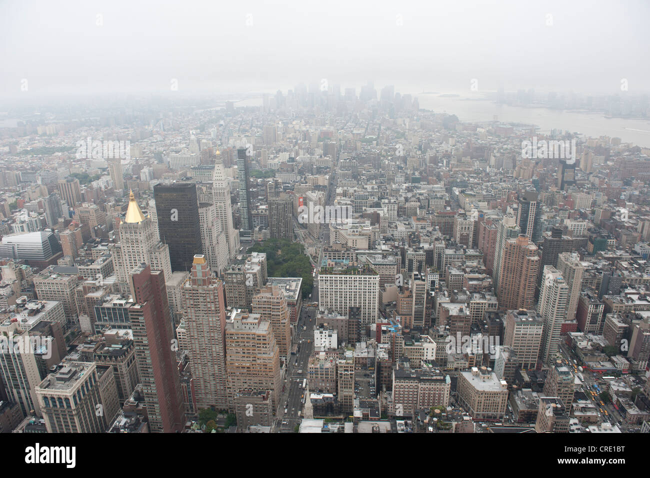 Metropolis, sea of houses, view from the Empire State Building to the skyscrapers of the Financial District in fog - Stock Image