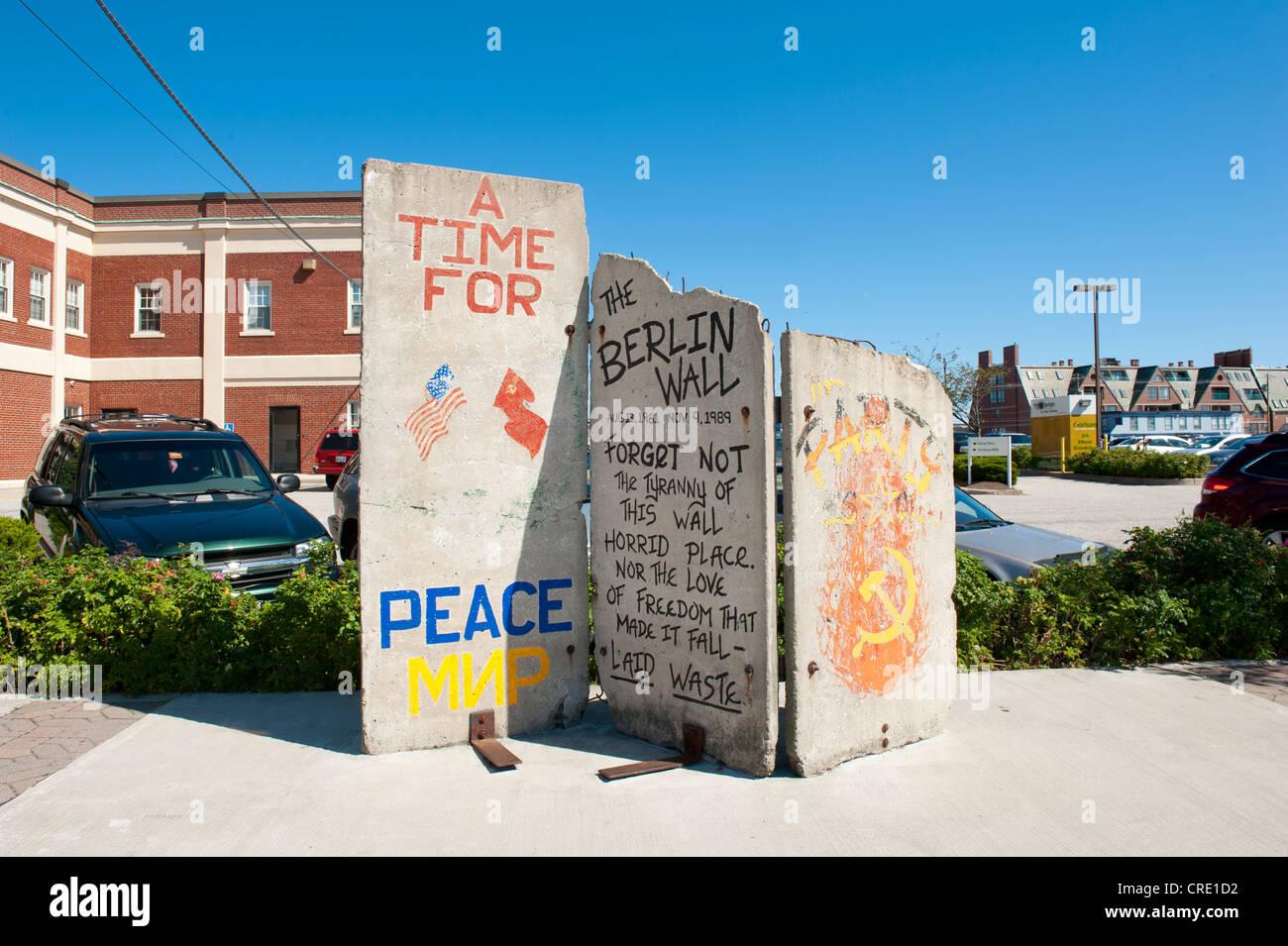 Three panels of the Berlin Wall, graffiti The Berlin Wall, on display at Long Wharf, Portland, Maine, New England, - Stock Image
