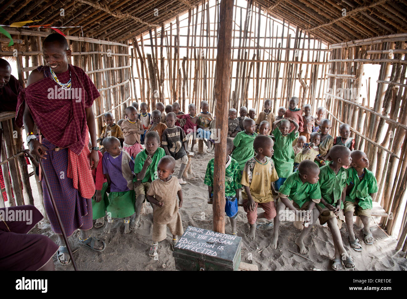Education and poverty, donations, school, children in a primary school, classes with a teacher, ethnology, Maasai - Stock Image
