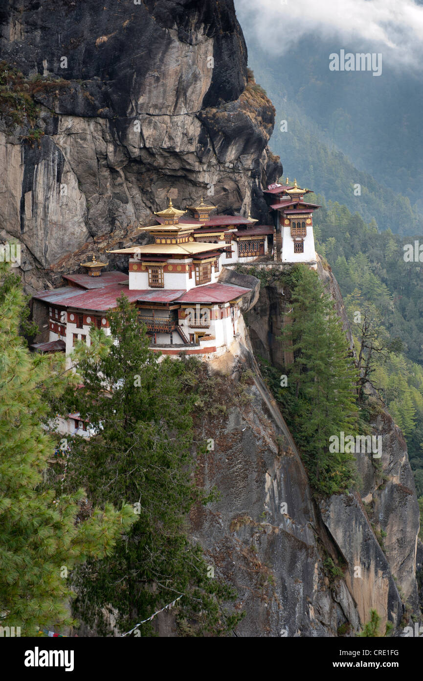 Tibetan Buddhism, Taktsang Palphug Monastery on a rock face, also known as The Tiger's Nest, near Paro, Himalayas, - Stock Image