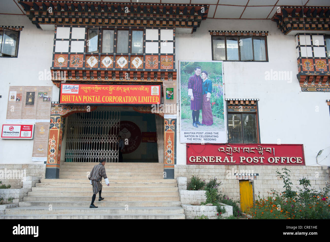 Post office, entrance to the main post office, picture of the royal couple on a wall, capital of Thimphu, the Himalayas - Stock Image
