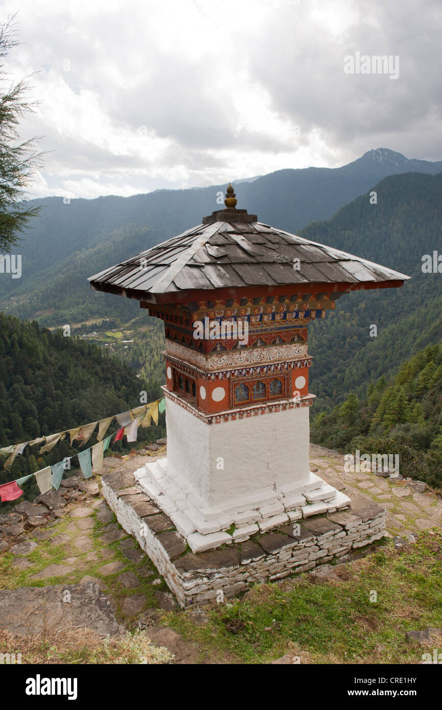Tibetan Buddhism, chorten, view of wooded mountains, Tango Goemba Monastery near Thimphu, the Himalayas, Kingdom - Stock Image