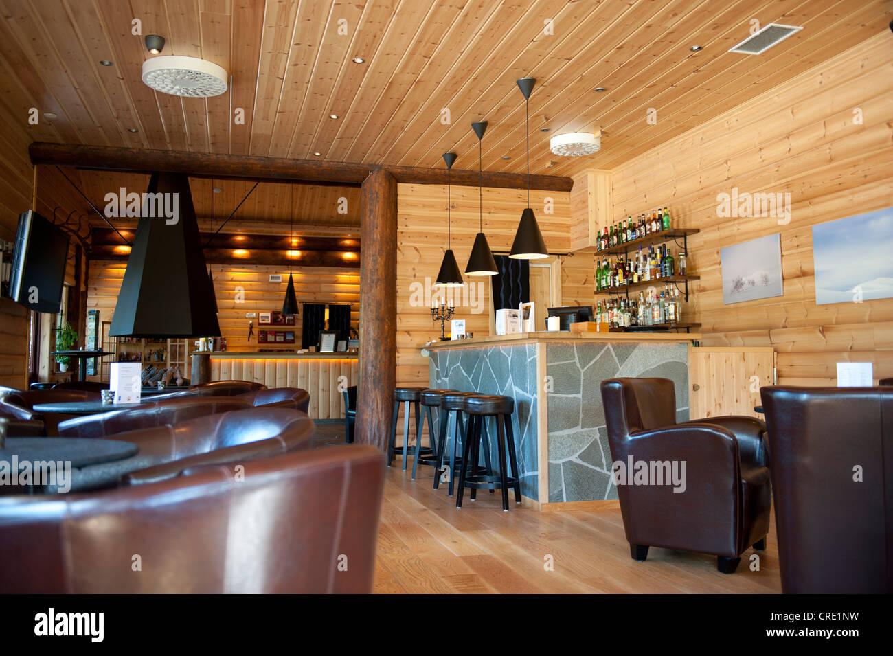 Reception and piano bar with leather armchairs, Storsaetra Fjaellhotell Hotel, near Groevelsjoen, Dalarna province, - Stock Image