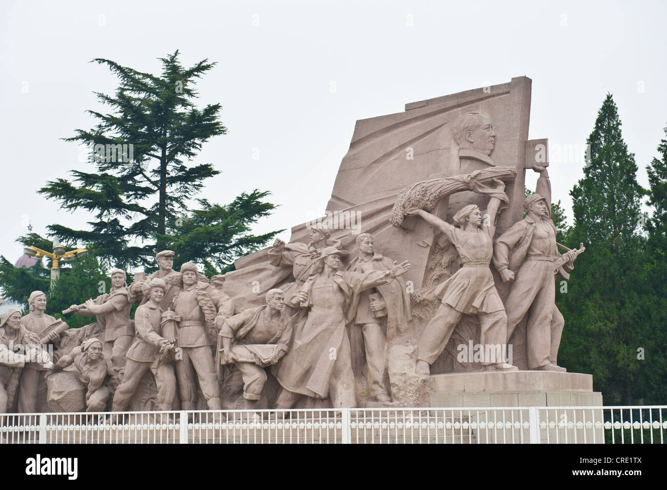 Communist stone monument, people with the flag of Mao Zedong, Tiananmen Square, Tiananmen Square, Beijing - Stock Image