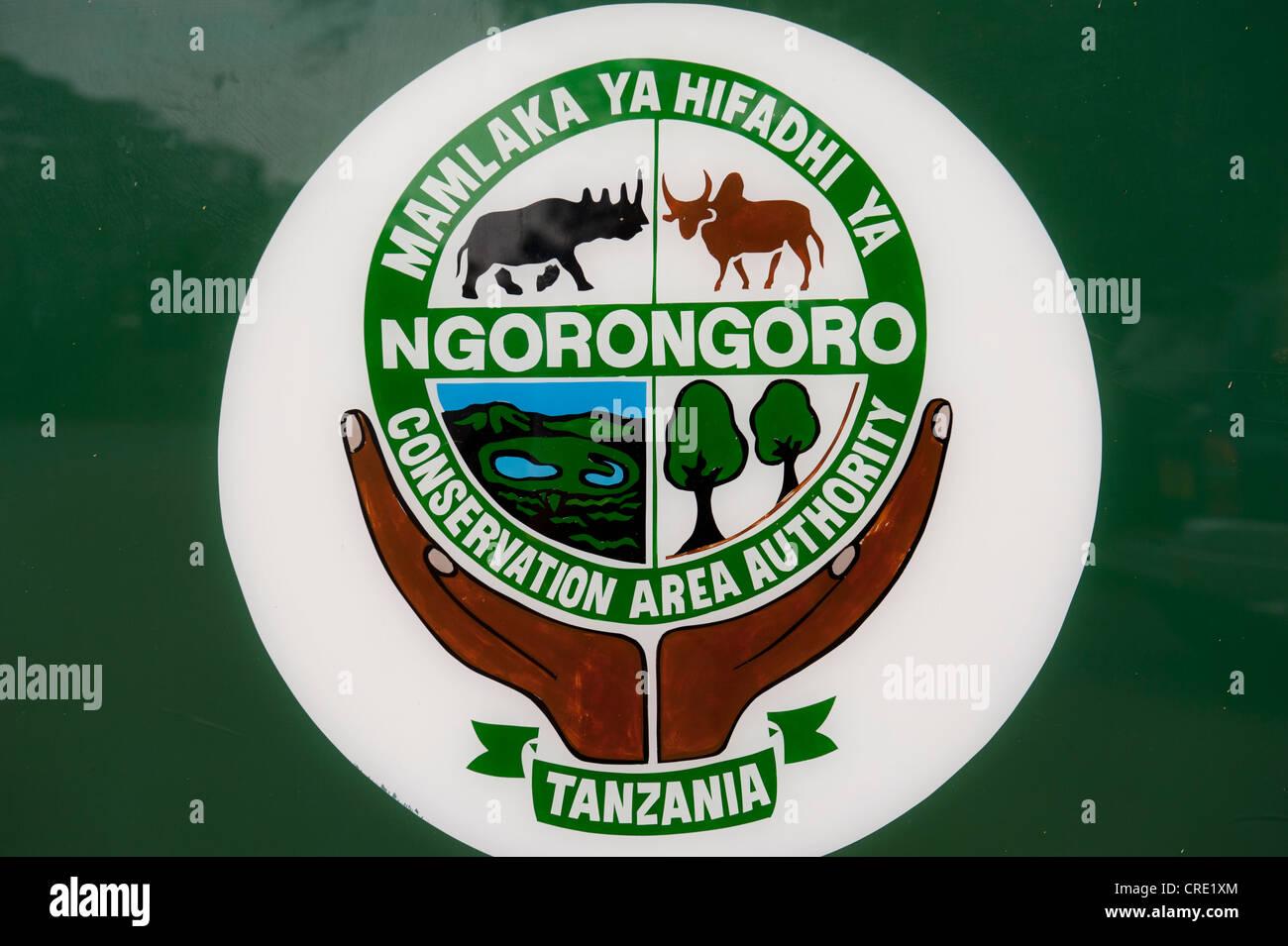 Conservation and tourism, sign and symbol, Ngorongoro Conservation Area Authority, Serengeti National Park, Tanzania - Stock Image