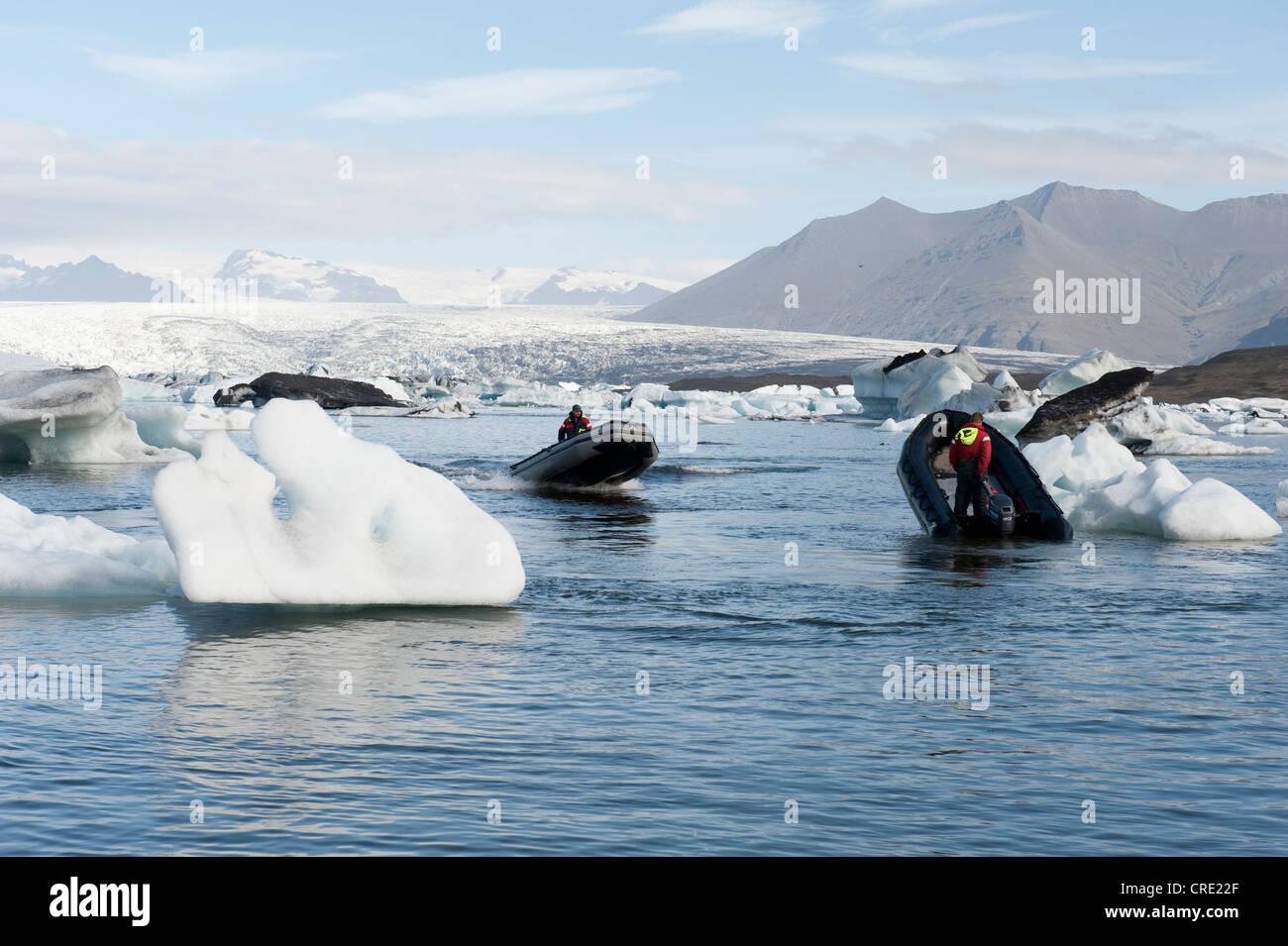 Motor boats, inflatable boats between icebergs, Joekulsárlón glacial lake, Joekulsarlon, Iceland, Scandinavia, - Stock Image