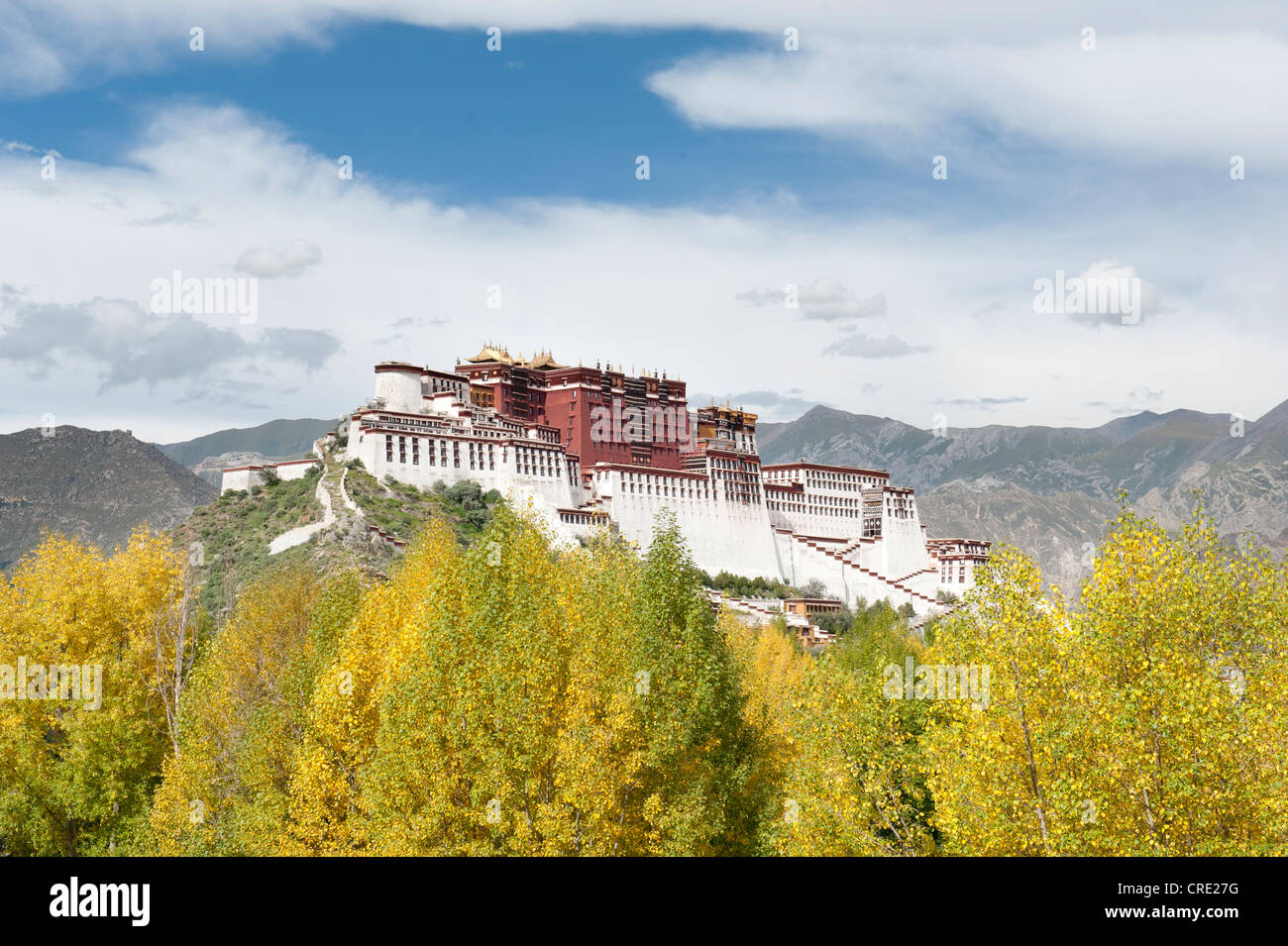 Tibetan Buddhism, Potala Palace, winter palace of the Dalai Llama, trees in yellow autumn foliage, Lhasa, Himalayas, - Stock Image