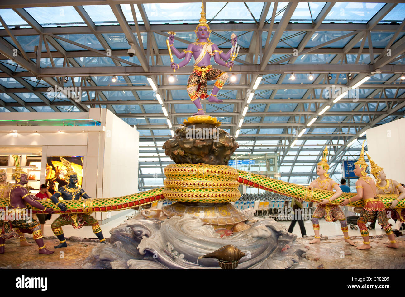 Modern group of statues, Hinduism, scene from the Ramayana epic, the churning of the milk ocean, God Shiva sitting - Stock Image