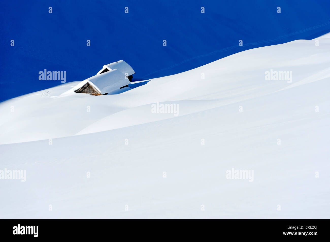 Snow-covered mountain chalet at Lake Truebsee near Engelberg Mountain, Obwalden, Switzerland, Europe - Stock Image