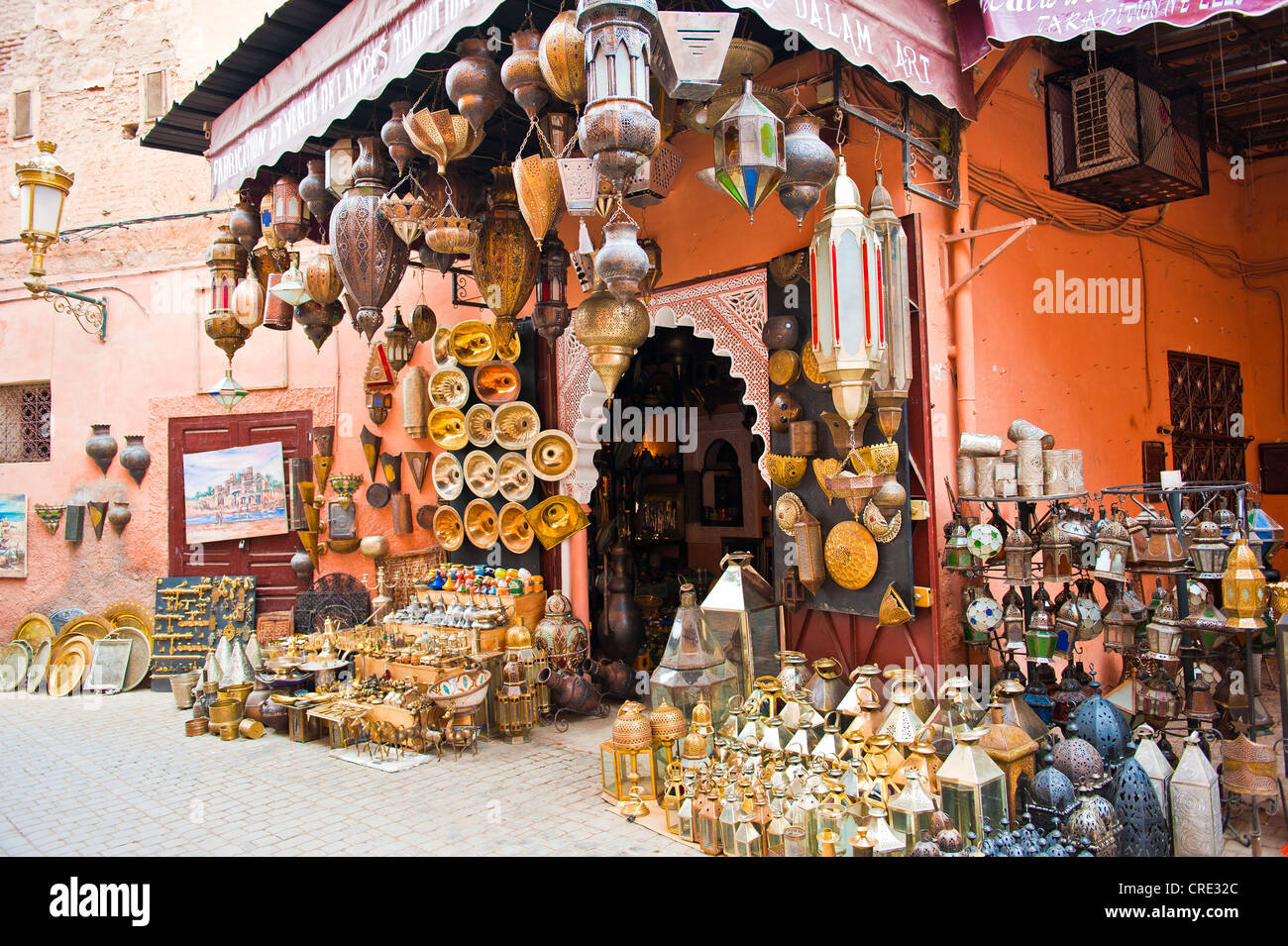 A trader has displayed lanterns, lamps and sinks made of brass, copper and other metal outside his shop for sale, - Stock Image