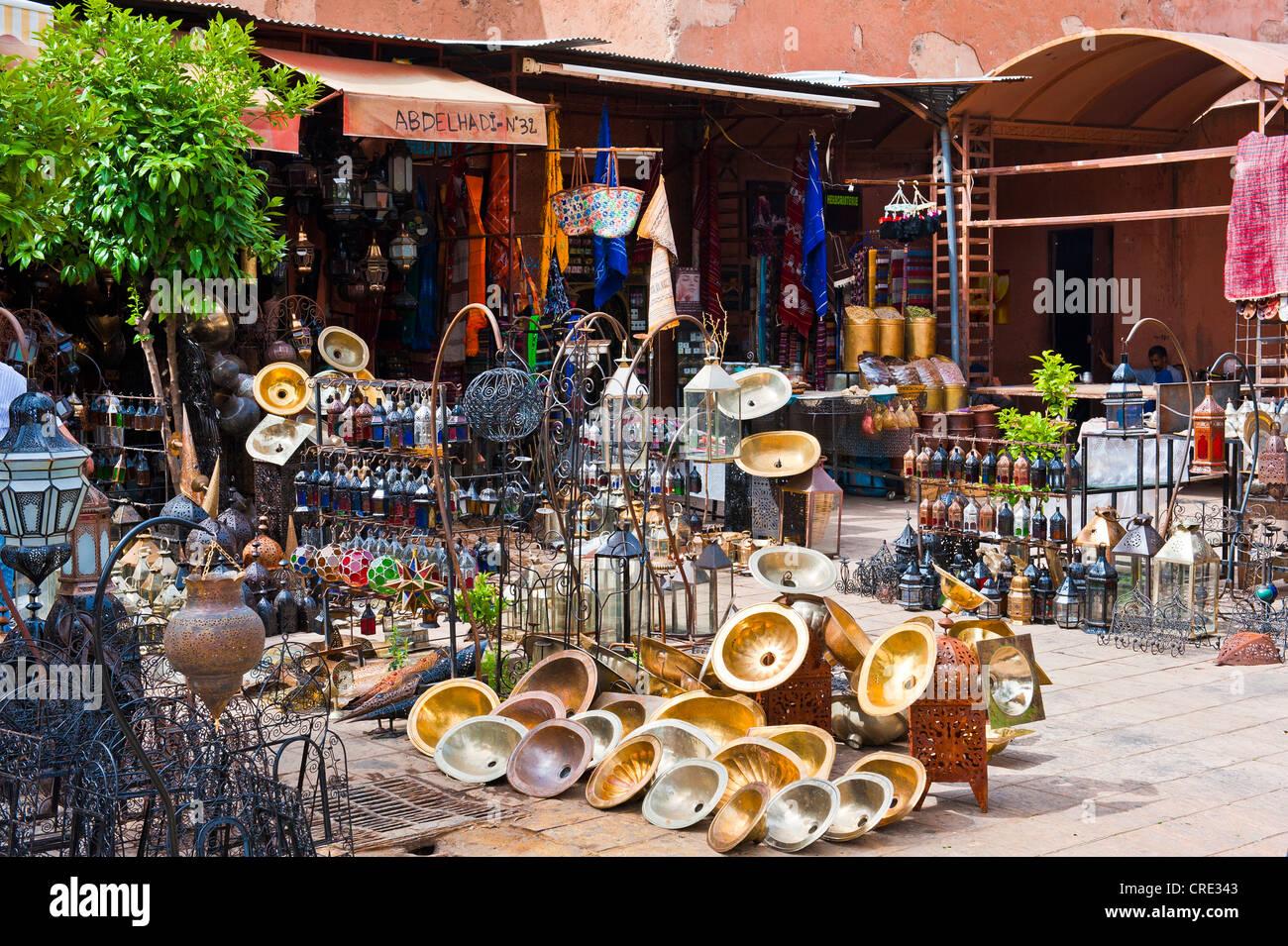 Traders and craftsmen have displayed lanterns, lamps, sinks made of brass, copper and other metal outside their - Stock Image