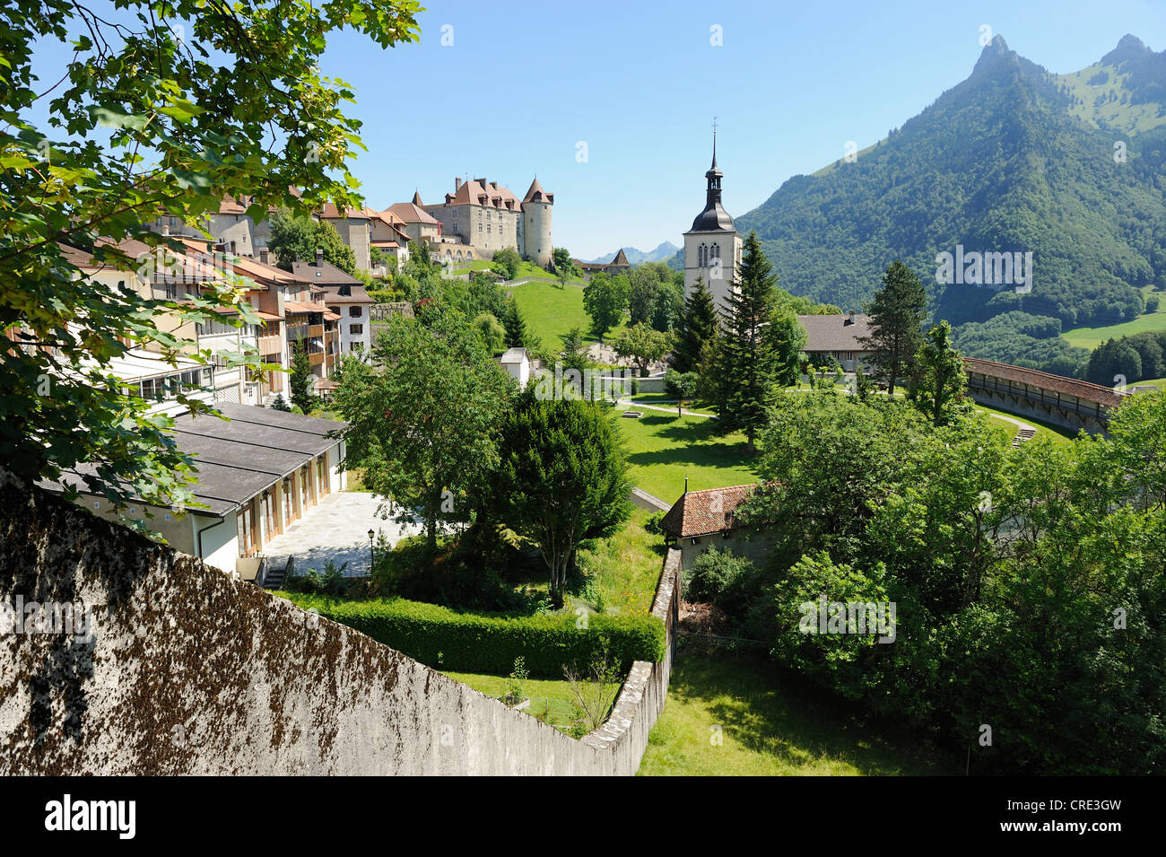Old city walls around the medieval town of Gruyères, Fribourg, Switzerland, Europe - Stock Image