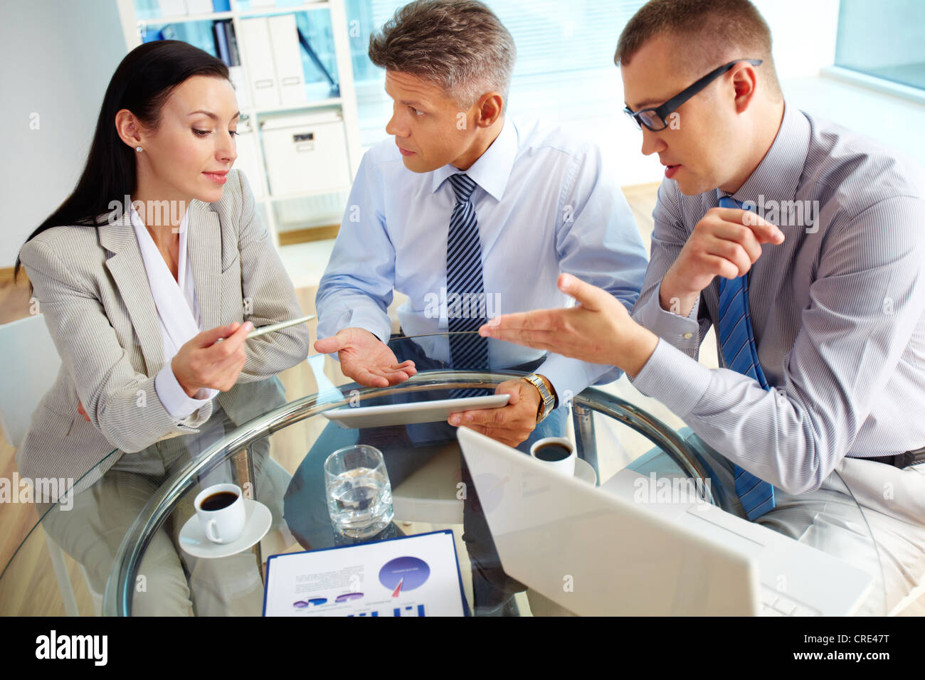 Energetic business people discussing the results of the latest strategic movements - Stock Image