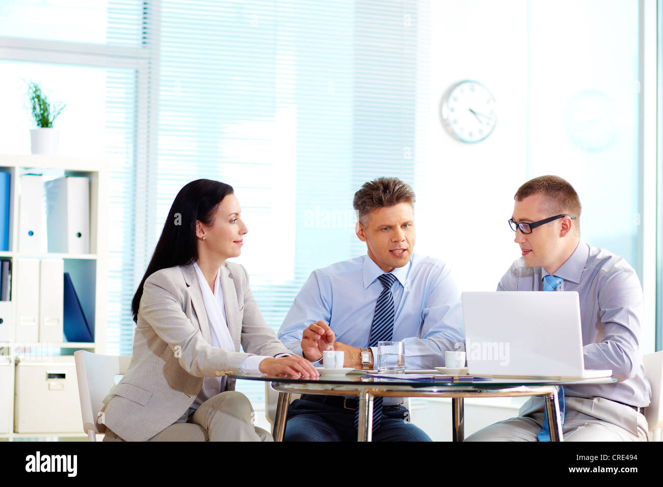 Business team being in the midst of discussion, copy-space provided - Stock Image