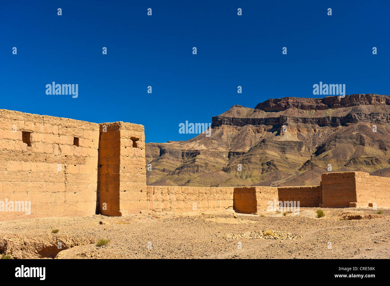 Taouirt Kasbah, mud fortress, mud brick buildings of the Berber tribes, Tighremt, Draa Valley, Southern Morocco, Stock Photo