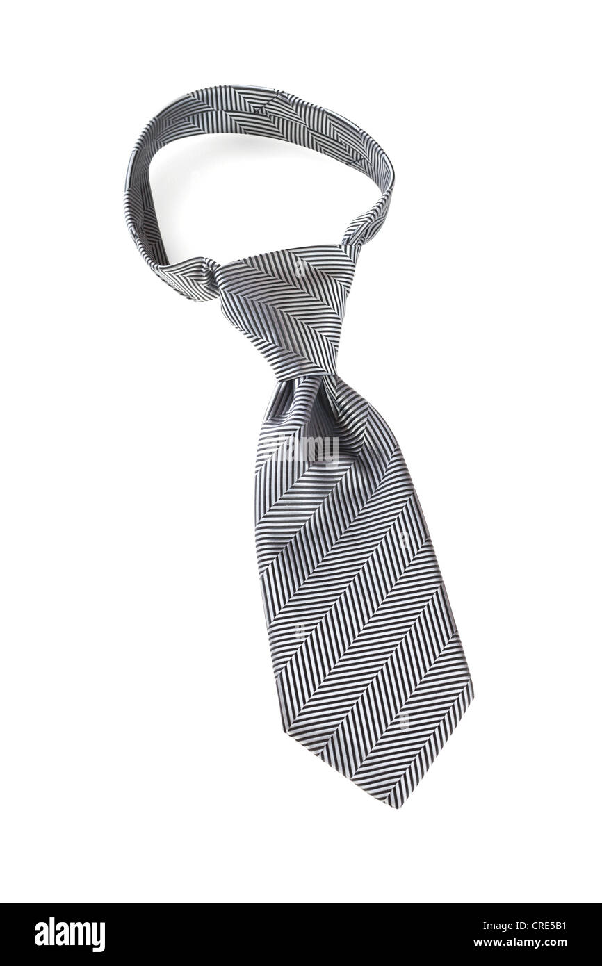 Grey necktie over white, with a windsor knot. - Stock Image