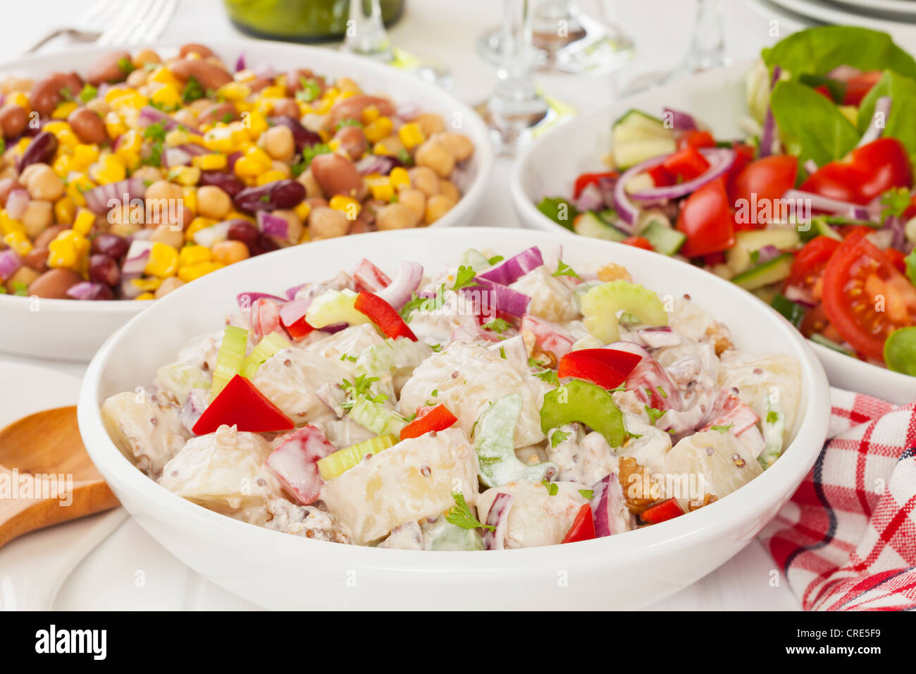 An assortment of salads on a buffet table - Stock Image