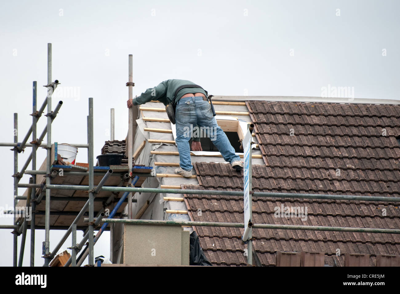 A familiar sight throughout the UK construction industry, a worker displays what is generally known as 'builders - Stock Image