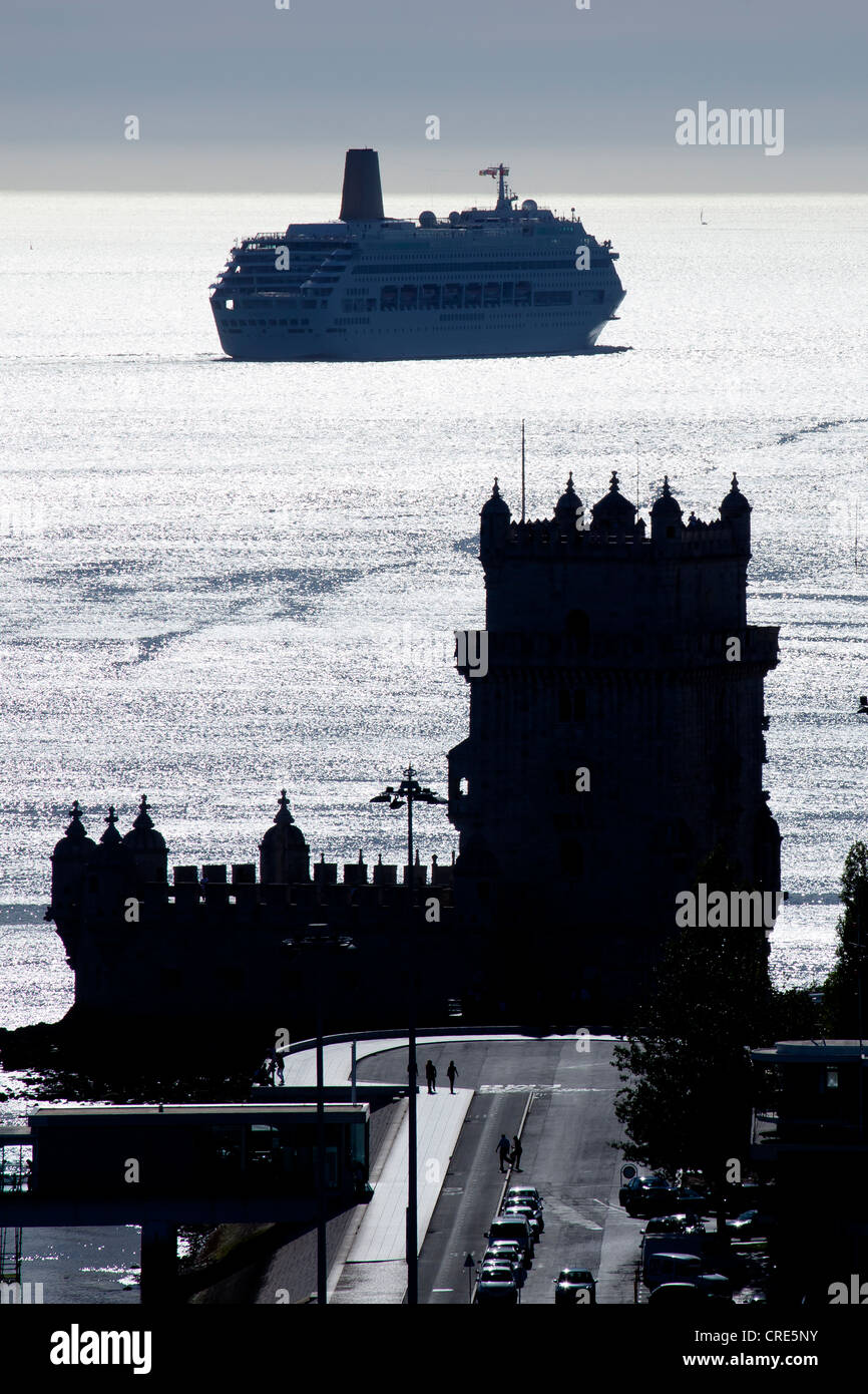 Cruise ship at the Torre de Belem, fortifications from the 16th Century, UNESCO World Heritage Site, at the mouth - Stock Image