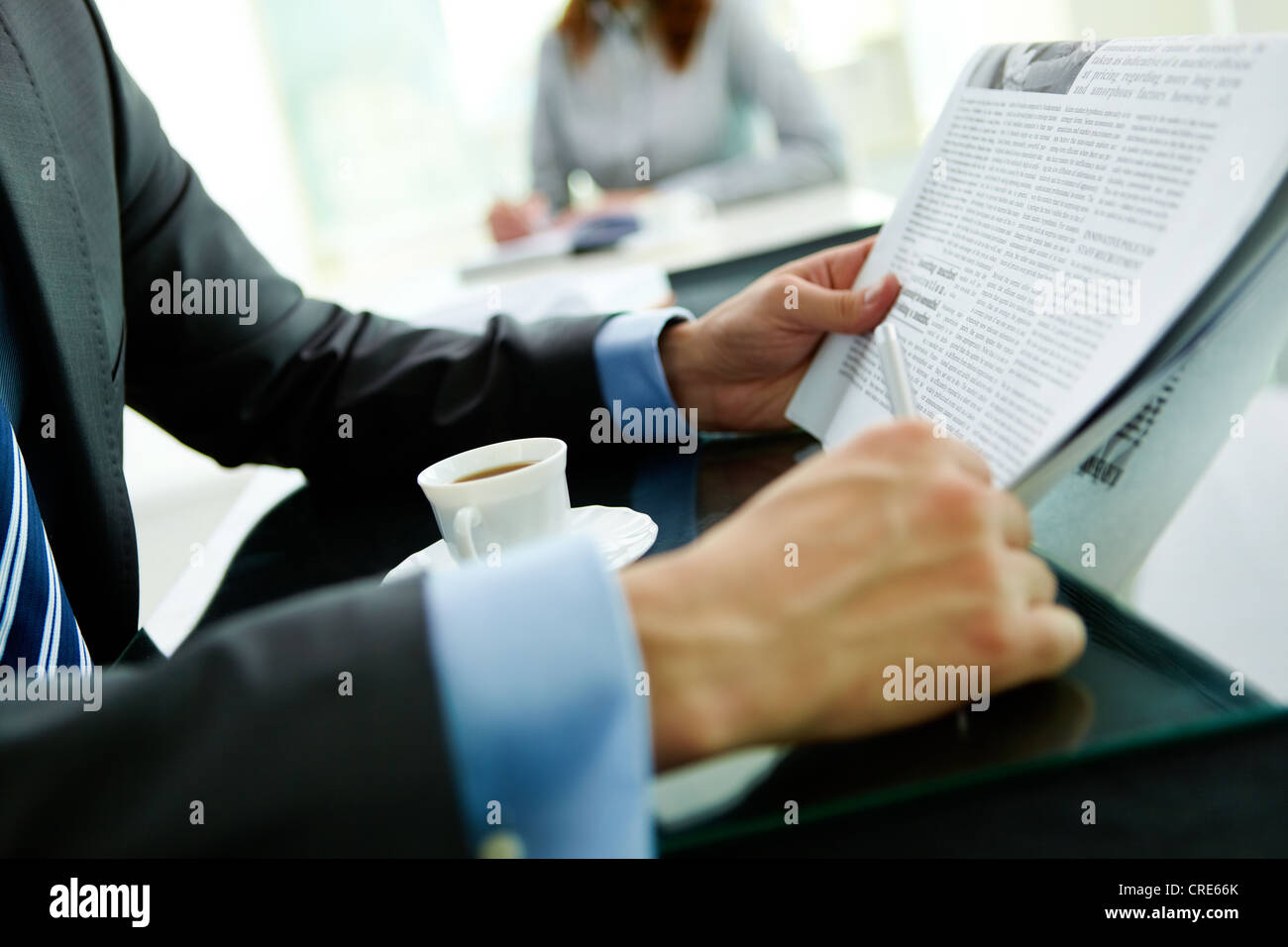 Close-up shot of a businessman reading the latest news - Stock Image