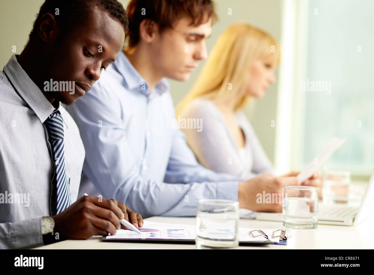 Group of business people taking their everyday work seriously - Stock Image