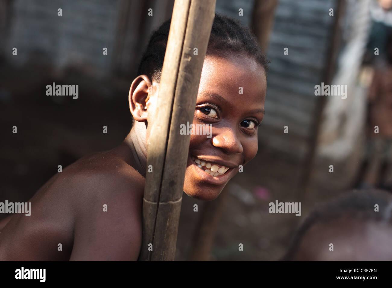 Portrait of a girl in the Clara Town slum of Monrovia, Montserrado county, Liberia on Thursday April 5, 2012. - Stock Image