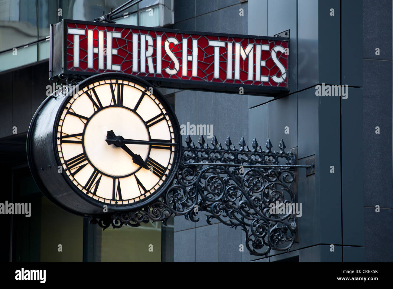 Clock on the editorial office and administration of the media company The Irish Times, Dublin, Ireland, Europe - Stock Image