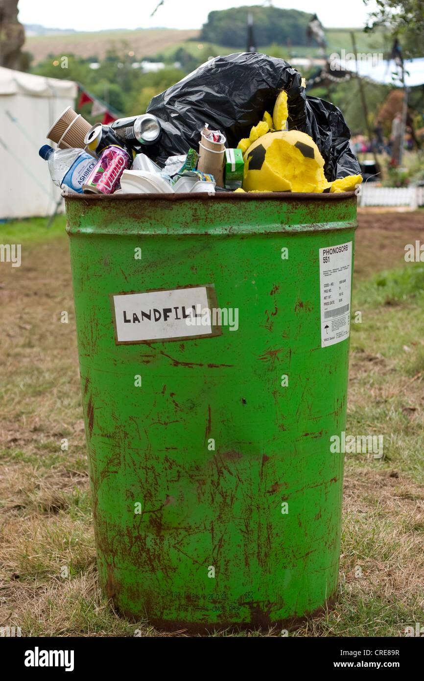 Overflowing Landfill bin - Stock Image
