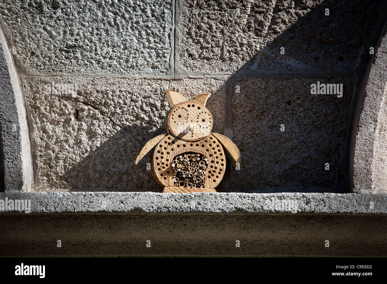 An owl-shaped insect house or nesting aid for wild bees and other insects. - Stock Image