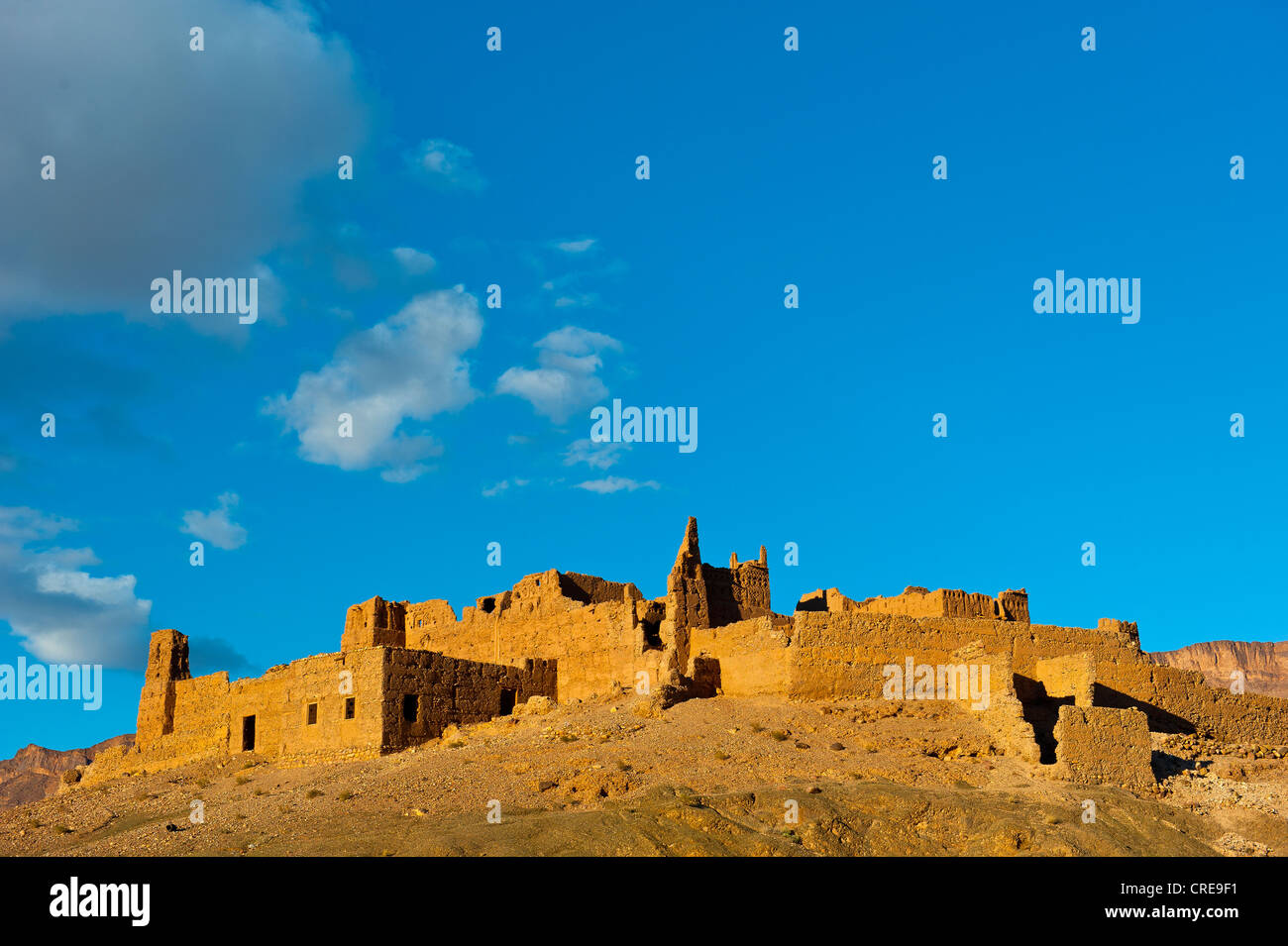 Ruined Kasbah on a hill, a former Berbers' house built of adobe, Draa Valley, southern Morocco, Morocco, Africa - Stock Image