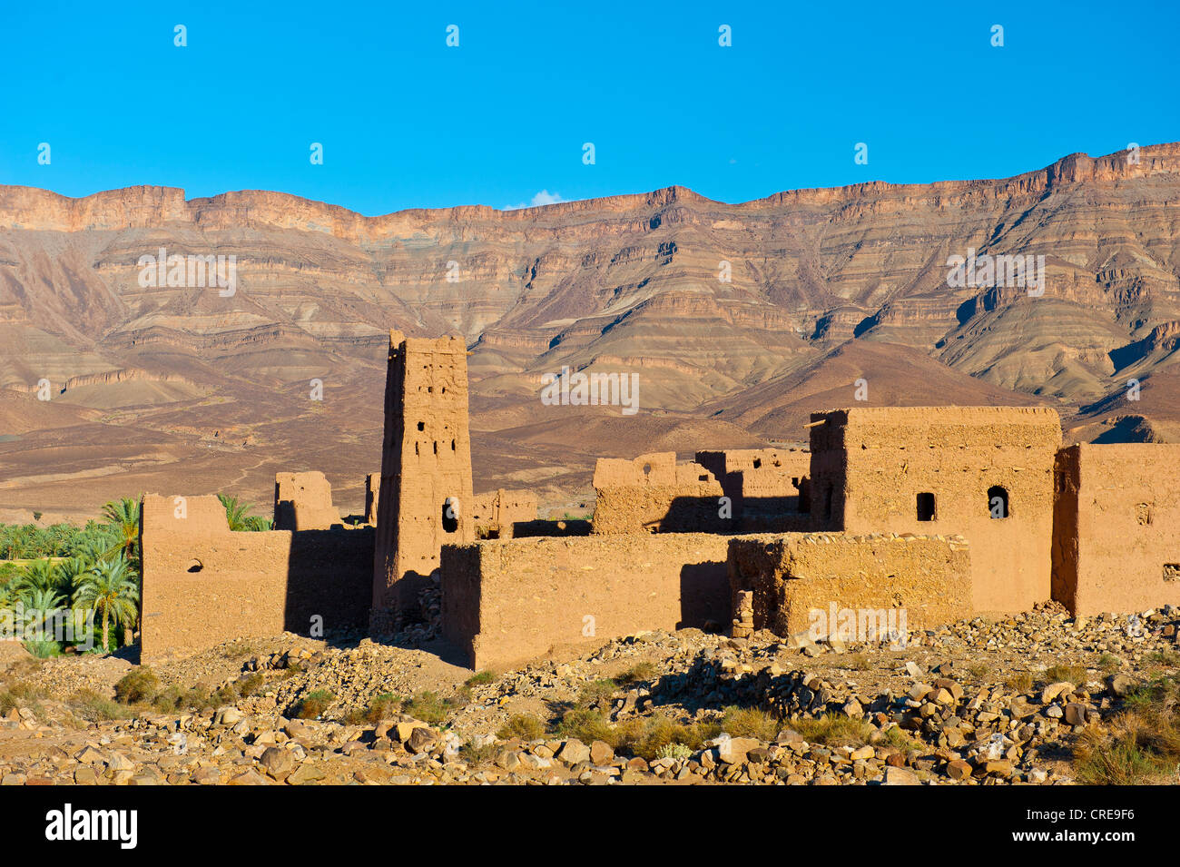 Ruined Kasbah, a former Berbers' house built of adobe, mountain range of the Djebel Kissane table mountain at - Stock Image