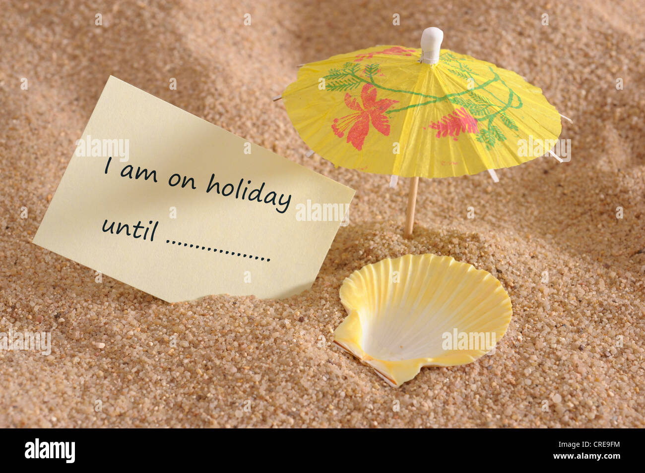 memo at beach marked with note for holiday - Stock Image