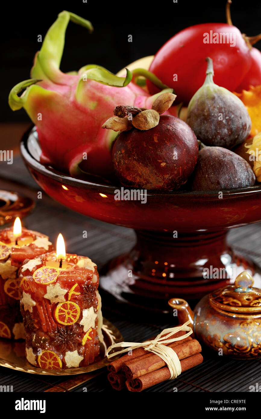 Still life with exotic fruits - mangosteen, fig, dragon fruit, horned melon, tamarillo - Stock Image