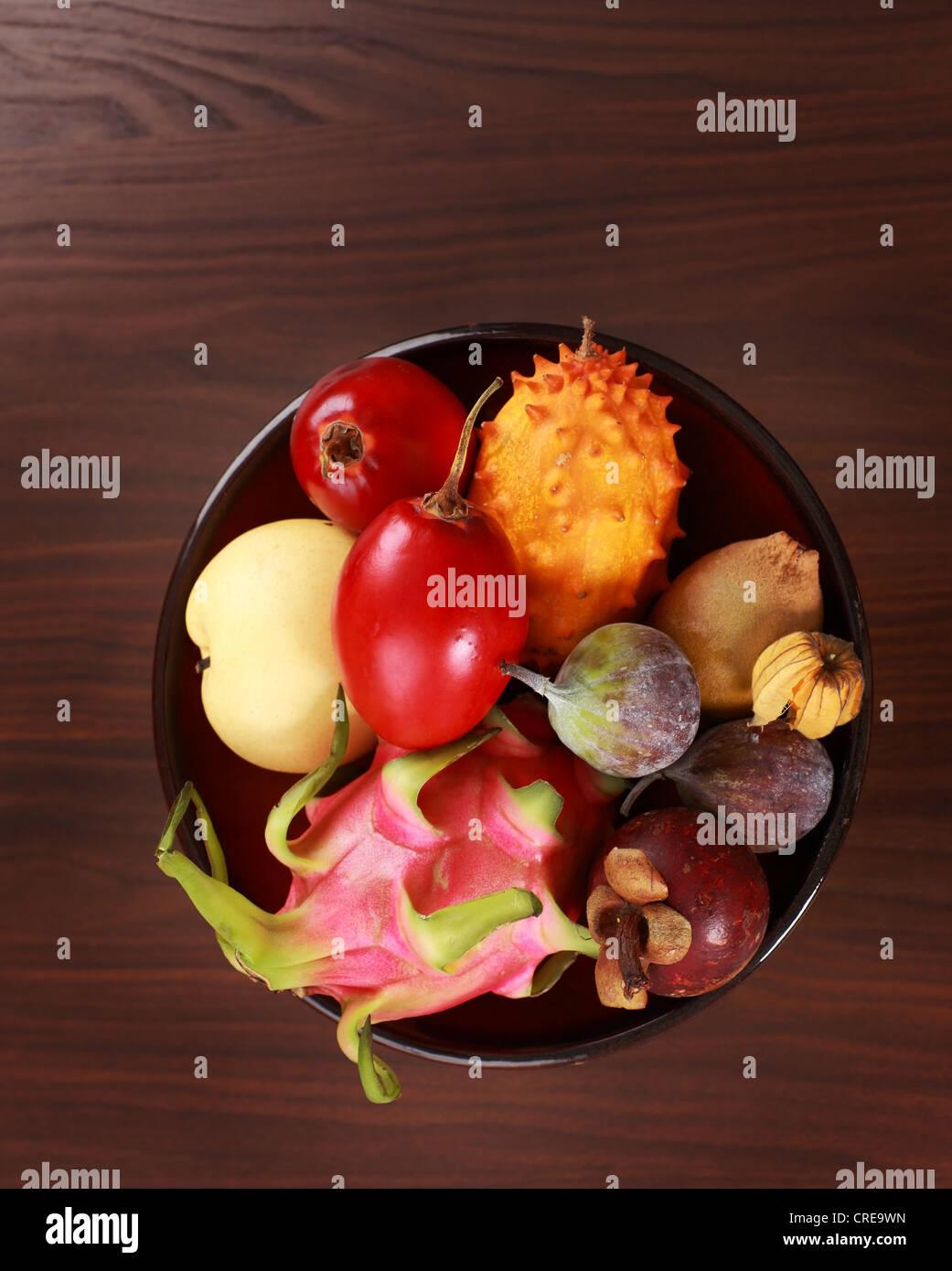 Exotic fruits - mangosteen, fig, mango, Asian pear, dragon fruit, horned melon, tamarillo - Stock Image