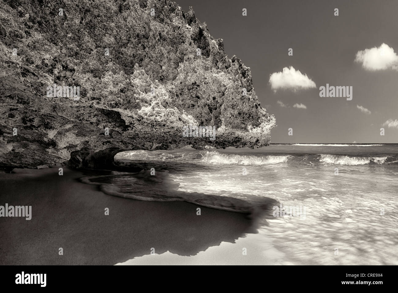 Rock overhang at Mudjin Harbor. Middle Caicos. - Stock Image