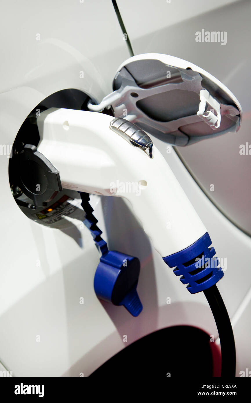 Charging with a 230 volt plug, pistol grip charger, on an electric car, 64th International Motor Show, IAA, 2011 - Stock Image