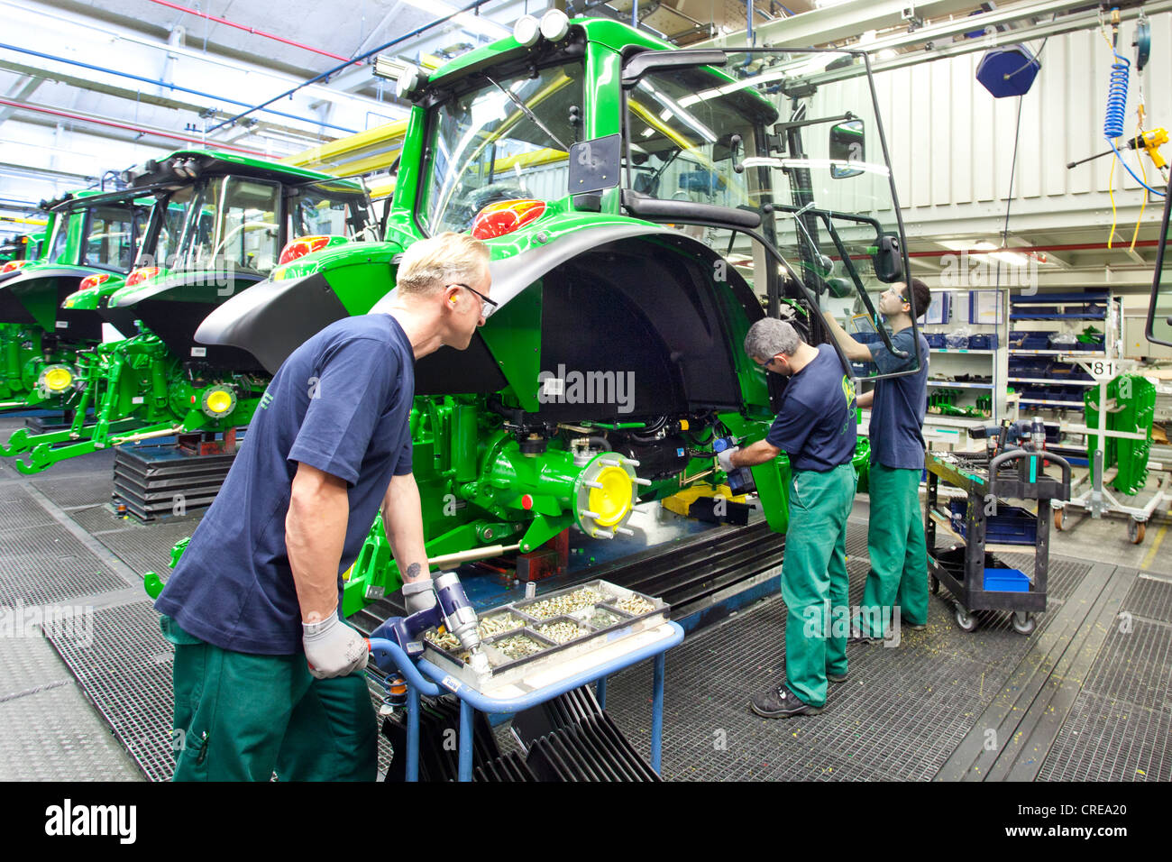 Assembly of doors in the tractor production section at the European headquarters of the American agricultural machinery - Stock Image