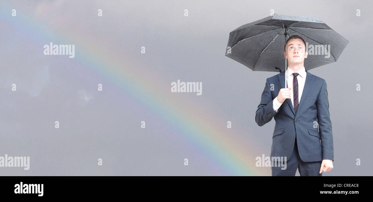 Worried business man on a rainy day - Stock Image