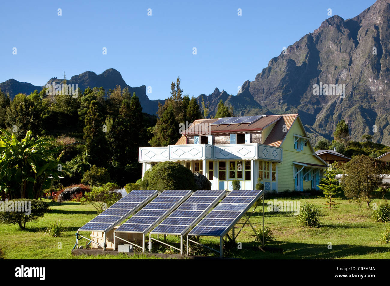 Mountain cottage with solar panels, photovoltaics, remote and hard to reach mountain village of La Nouvelle - Stock Image